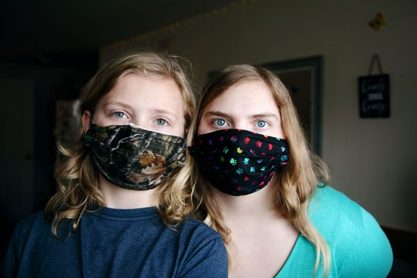 Mother and daughter wearing Covid-19 face masks
