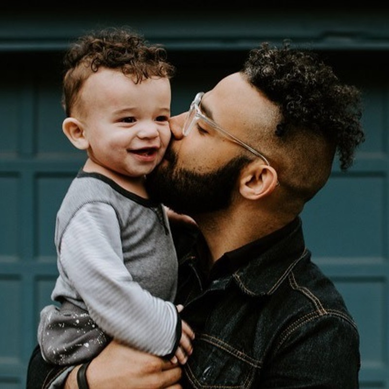 Guy Kissing Baby
